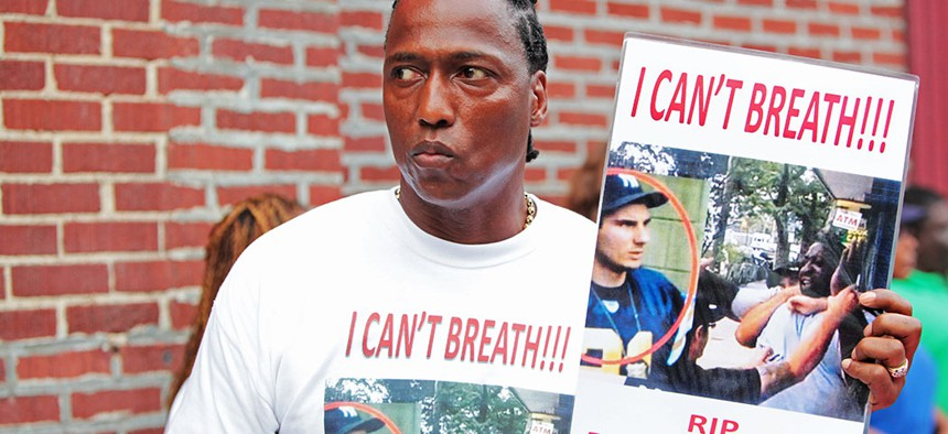 A man attending funeral services for Eric Garner, the Staten Island resident who died while being taken into custody by an NYPD officer in 2014.