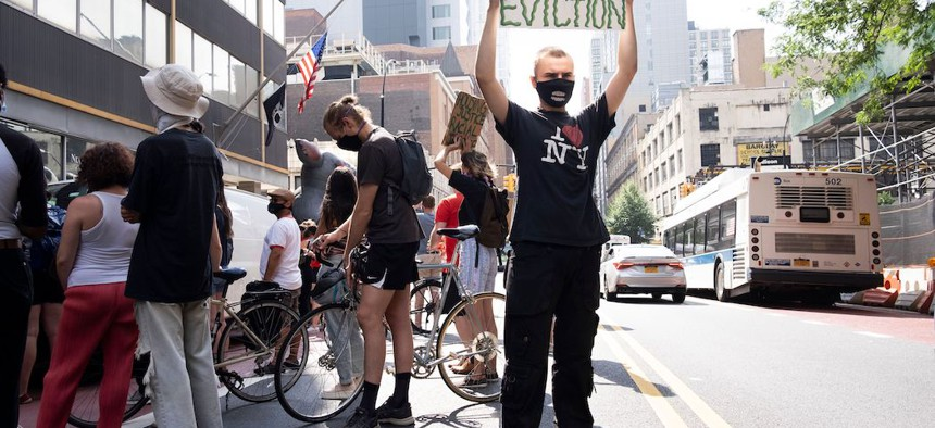 People participate in a protest calling on New York to cancel rent outside of a New York Civil Court in Brooklyn on July 7, 2020.