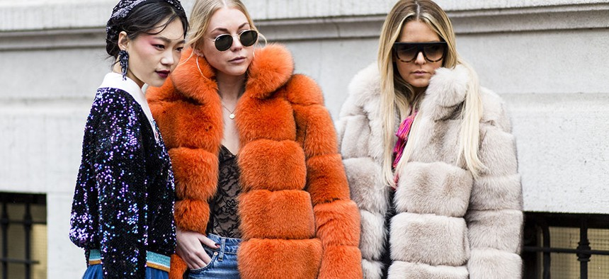 Fashion models sporting luxe faux-fur looks.