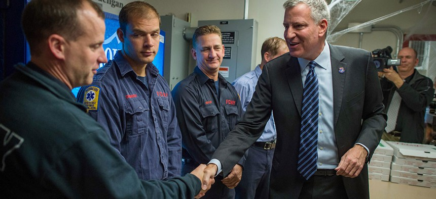 Mayor Bill de Blasio visits FDNY EMS Station 10 to thank FDNY members for their service in 2014.