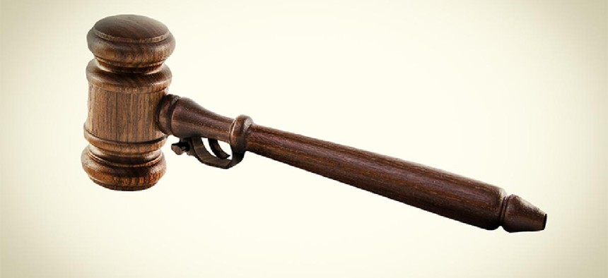 A gavel and a gun mixed together