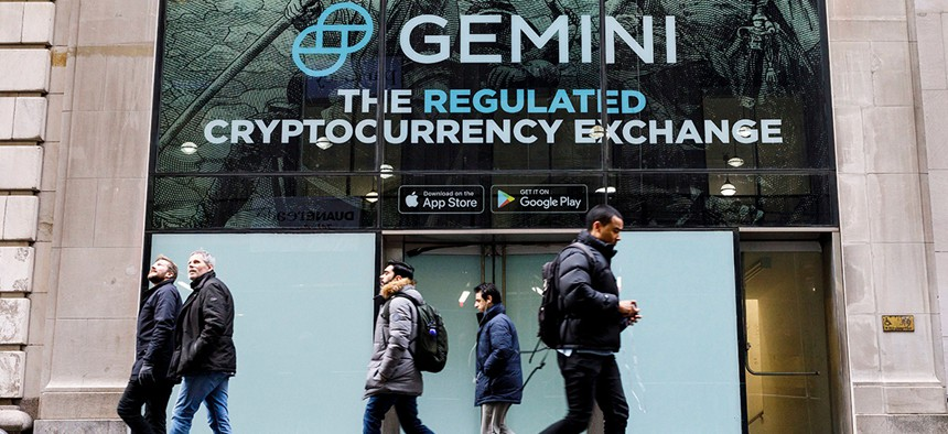 New Yorkers walk past an advertisement for Gemini, a cryptocurrency exchange founded in 2014.