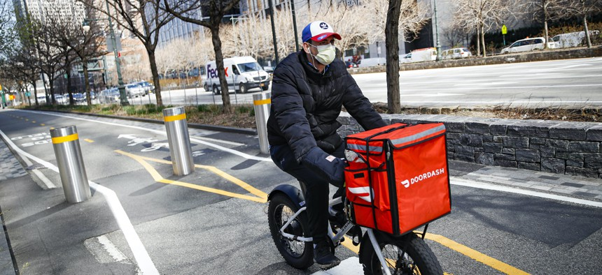 A bike delivery worker in NYC in March of this year.