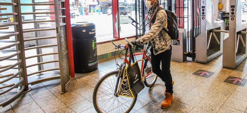 A food delivery worker seen on the subway during the coronavirus outbreak on March 25th.