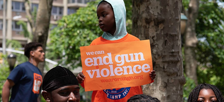 """Protestors at the """"Walk In Solidarity With Survivors"""" to end gun violence in New York City."""