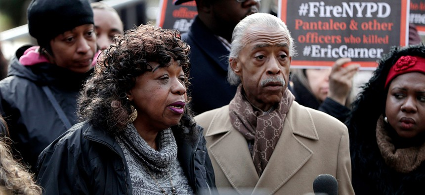 Gwen Carr, mother of Eric Garner, stands with Rev. Al Sharpton during a news conference outside of New York Police headquarters.