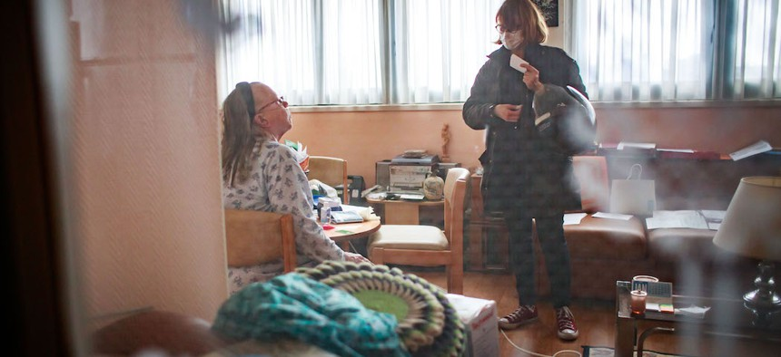 A home care worker in France visiting her patient this month, in the United States home care workers are having trouble getting access to the materials they need to face COVID-19.