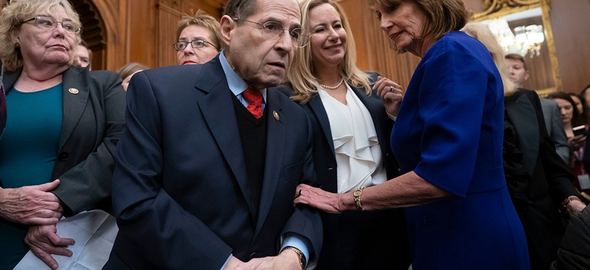 Speaker of the House Nancy Pelosi, right, speaks with New York Rep. Jerrold Nadler, chairman of the House Judiciary Committee, as she unveils a comprehensive elections and ethics reform package in early January.