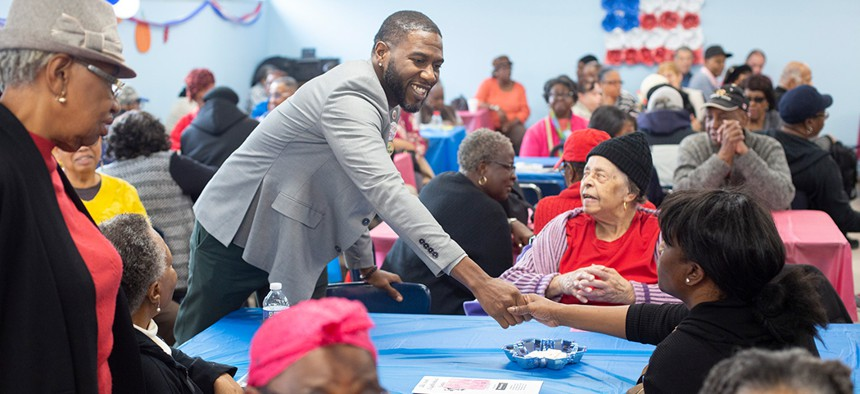 New York City Councilman Jumaane Williams shakes hands at the Canarsie Senior Center on Veterans Day.