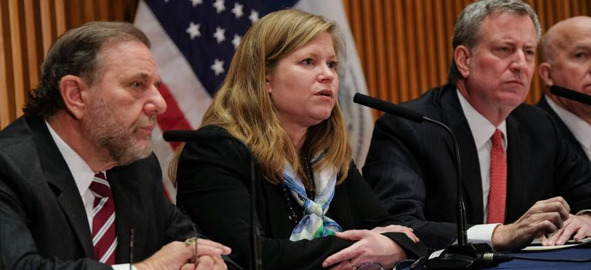 Resigning Sanitation Commissioner Kathryn Garcia with Bill de Blasio 2018.