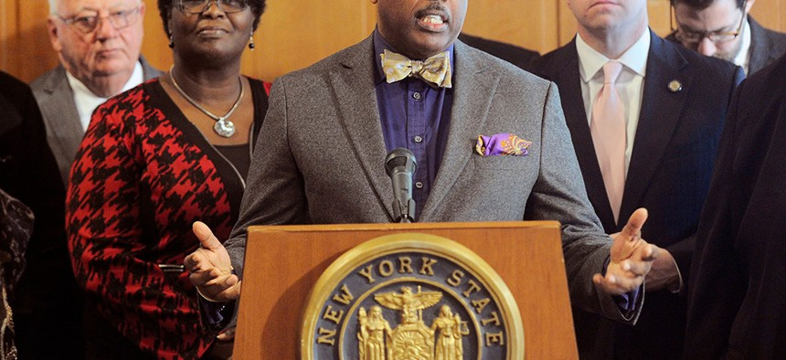 New York Senator Kevin Parker stands with Senate members during a press conference