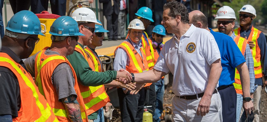Governor Cuomo shakes hands with MTA construction workers.