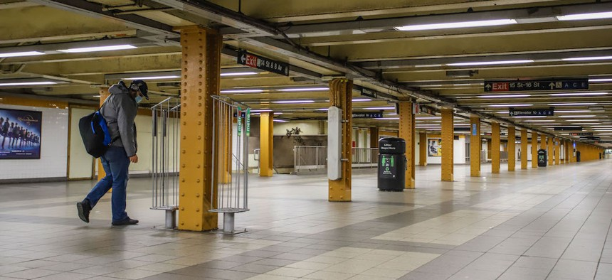 A lone man in the 14th Street subway station on April 10th.