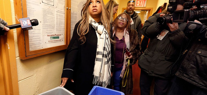 Lynne Patton catching a water leak with trash bins in the Douglas Houses in New York in February, during her four weeks of living in four different New York City Housing Authority buildings.