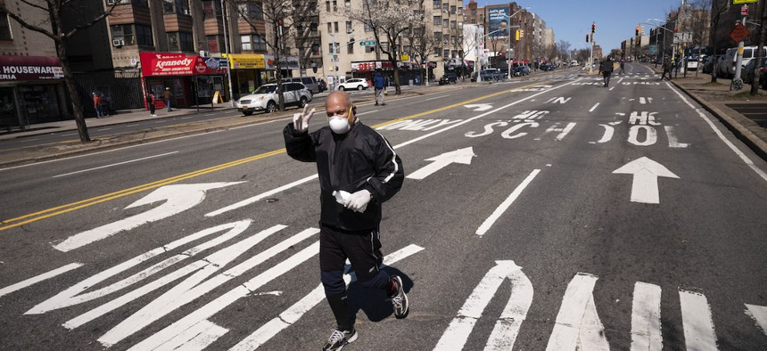 A man jogs along a section of the Grand Concourse in the Bronx that has been temporarily closed in an effort to provide more social distancing space.