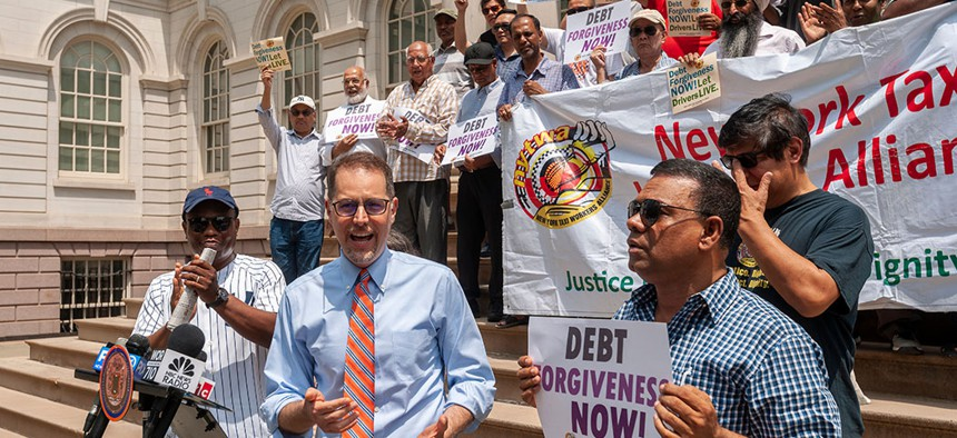 NYC Council Member Mark Levine speaks at a press conference with taxi drivers on the steps of NY City Hall calling for debt forgiveness for their medallions, July 11.