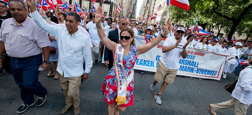 Former New York City Council Speaker Melissa Mark-Mark Viverito marches in the 2014 Puerto Rican Day parade.