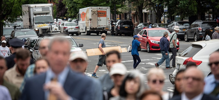 Traffic behind New York City Mayor Bill de Blasio's press conference announcing a redesign of 9th St. in Park Slope and calling for speed-camera expansion.