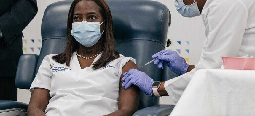 Nurse Sandra Lindsay is the first New Yorker to receive a federally approved COVID-19 vaccine