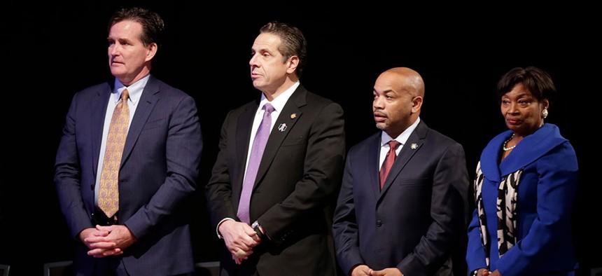 Former senate majority leader John Flanagan, New York Gov. Andrew Cuomo, Assembly Speaker Carl Heastie, and Senate Majority Leader Andrea Stewart-Cousins.