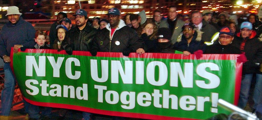 Transit workers march across the Brooklyn Bridge, in New York for a rally on the steps of City Hall in December 2002.