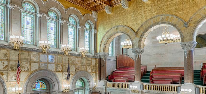 An empty New York State Senate chamber.