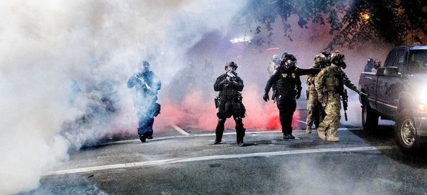 Federal officers use crowd control munitions to disperse Black Lives Matter protesters in Portland on July 21st.