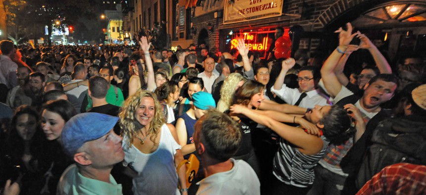 People celebrate the legalization of same-sex marriage in New York outside of Stonewall Inn in Manhattan, where the gay rights movement is considered to have started in 1969.