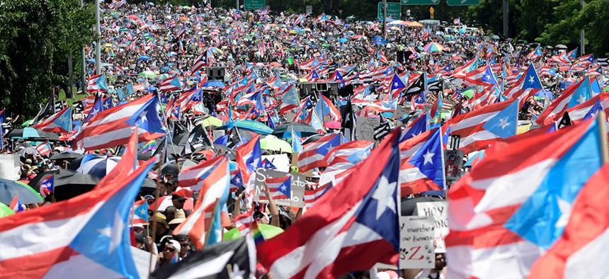 Demonstrators march on Las Americas highway demanding the resignation of governor Ricardo Rosselló, in San Juan, Puerto Rico.