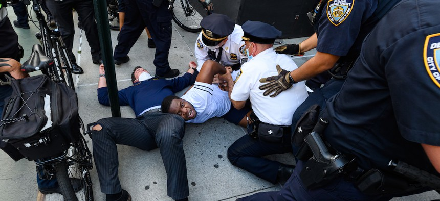 NYPD officers arrest a protester in Union Square during a rally responding to the death of Minneapolis man George Floyd at the hands of police.
