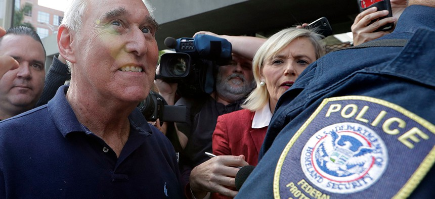Roger Stone leaves the federal courthouse following his arrest for lying to Congress and obstructing the special counsel's Russia investigation.
