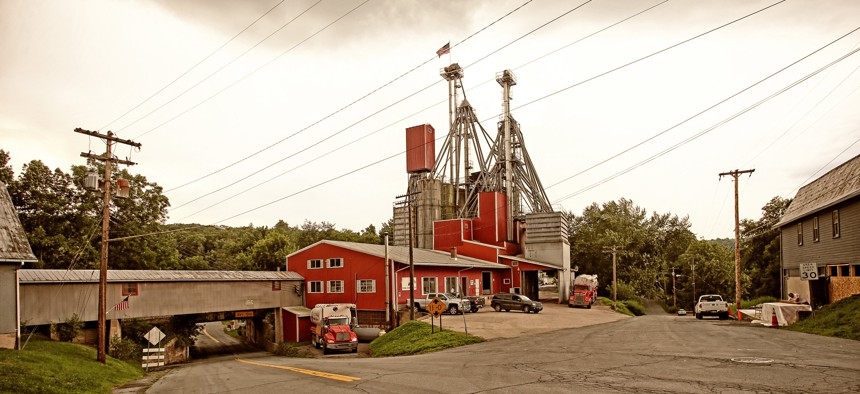 View of main street and rural grain mill in small western New York town.