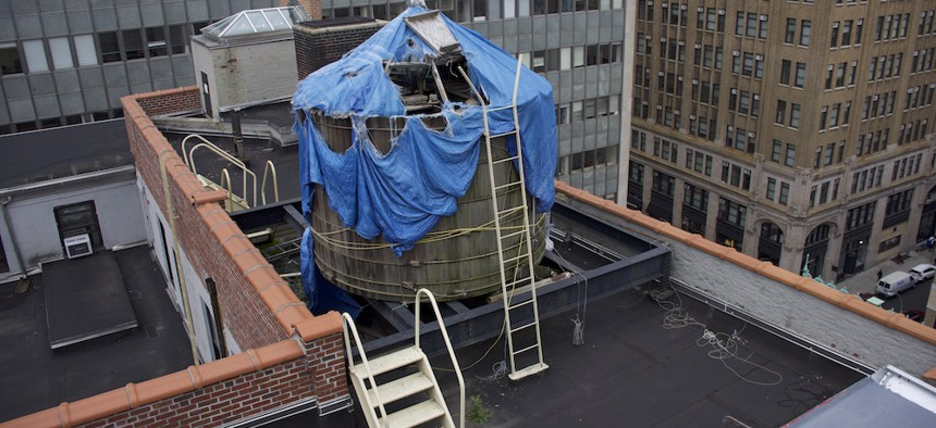The drinking water supply for offices of the New York City Department of Sanitation doesn't even have a roof – just a tattered tarp.