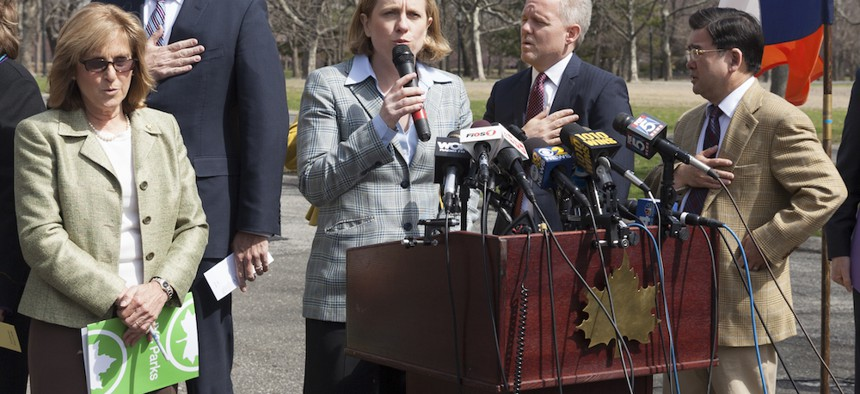 Rep. Joe Crowley, Queens Borough President Melinda Katz, City Councilman Jimmy Van Bramer and more sing the national anthem to celebrate 50th anniversary of World's Fair in Queens Flushing Meadows Park in 2014.