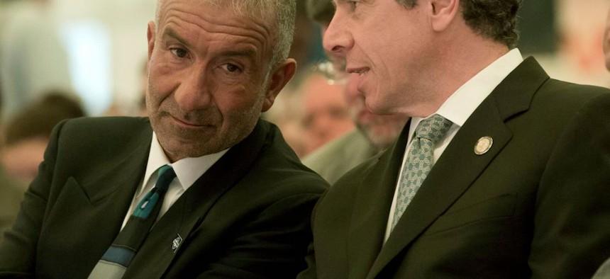 Gov. Andrew Cuomo talks with Alain Kaloyeros