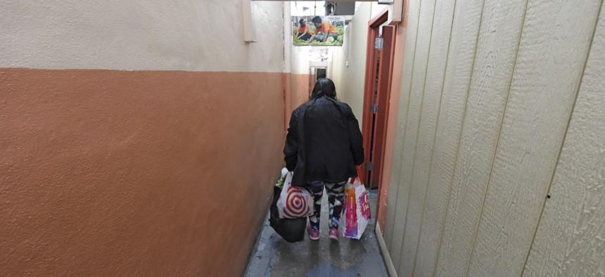 A client exits a Brooklyn-based food bank.
