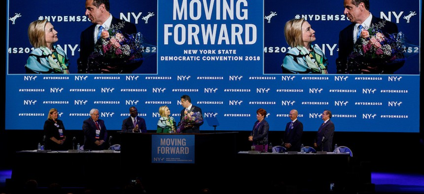 Gov. Andrew Cuomo greets former Secretary of State Hillary Clinton at the state Democratic convention Wednesday in Hempstead.