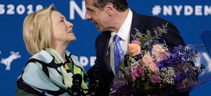 Hillary Clinton is greeted by Gov. Andrew Cuomo after speaking during the state Democratic convention in Hempstead.