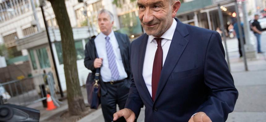 Alain Kaloyeros, right, leaves federal court in New York.