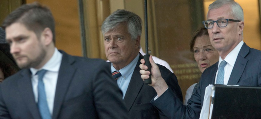 Dean Skelos and his wife Gail leave federal court in New York.