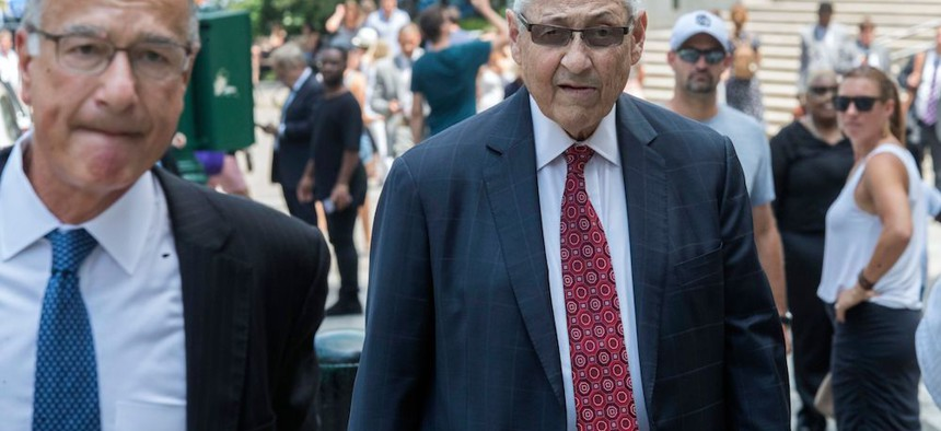 Former Assembly Speaker Sheldon Silver, right, arrives at federal court in New York prior to being sentenced for a second time.