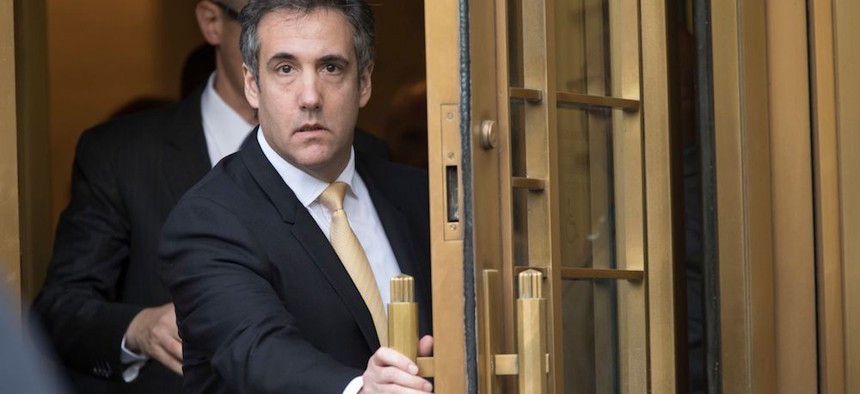 Michael Cohen, President Donald Trump's former personal lawyer, leaves federal court in Manhattan on Tuesday after reaching a plea agreement with prosecutors.