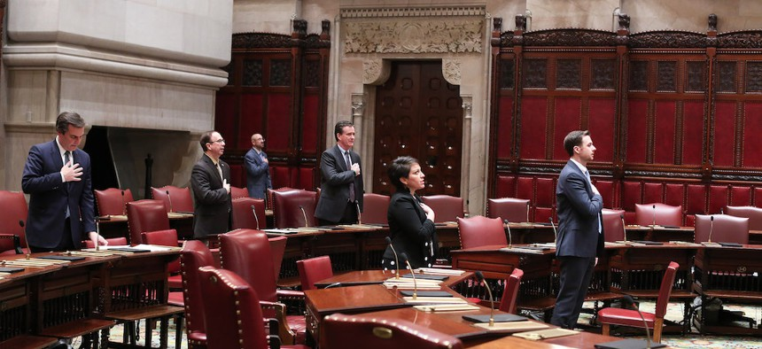A scattering of state Senators on the Senate floor March 29th.