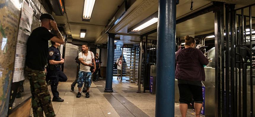Police minding the subway entrance.