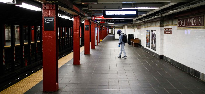A lone subway customer wears protective gloves on March 21st.