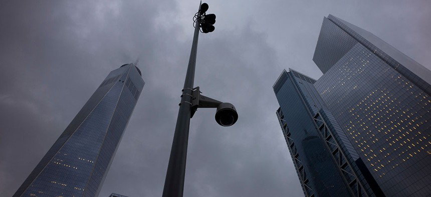 A light pole with a surveillance camera at the World Trade Center.
