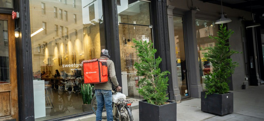 Doordash bike delivery person.
