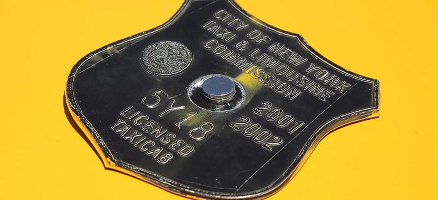 A vintage New York City taxi medallion.