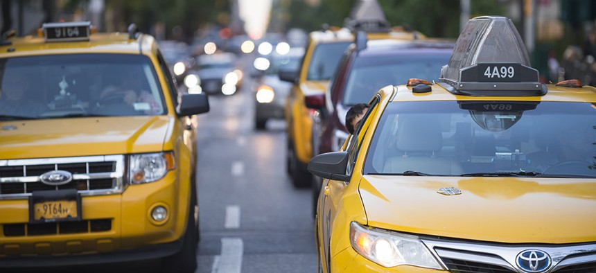 Taxis driving throughout the city.