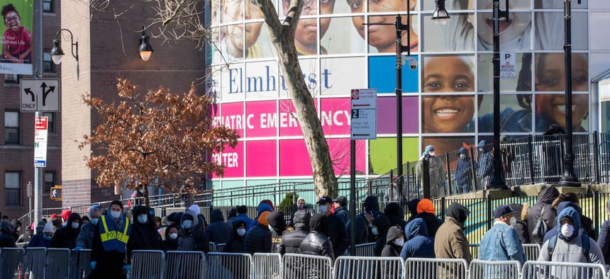 People line up outside Elmhurst Hospital Center in Queens to be tested for the coronavirus.